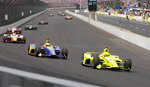 Simon Pagenaud, of France, leads Alexander Rossi and Takuma Sato, of Japan, into the first turn in the closing laps Indianapolis 500 IndyCar auto race at Indianapolis Motor Speedway, Sunday, May 26, 2019, in Indianapolis. Pagenaud has won his first Indy 500, making an audacious pass of Rossi before taking the white flag and holding of the hard-charging driver from Andretti Autosport. (AP Photo/R Brent Smith)