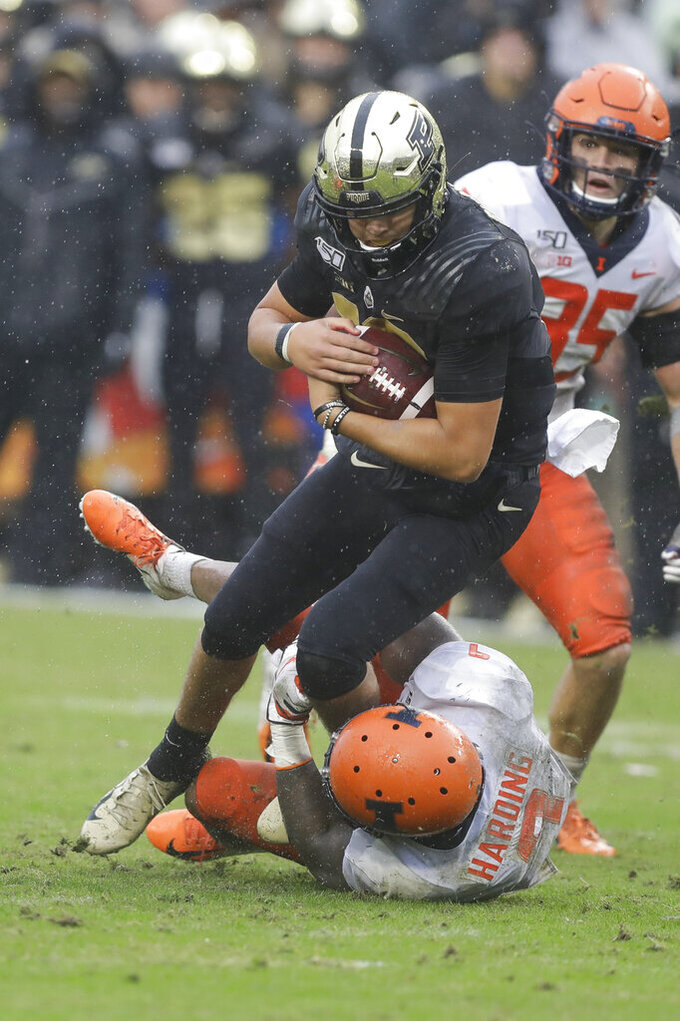 Purdue quarterback Aidan O'Connell (16) is tackled by Illinois linebacker Dele Harding (9) during the second half of an NCAA college football game, Saturday, Oct. 26, 2019, in West Lafayette, Ind. (AP Photo/Darron Cummings)