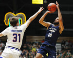 Nevada forward Caleb Martin shoots over Colorado State forward Adam Thistlewood during the first half of an NCAA college basketball game Wednesday, Feb. 6, 2019, in Fort Collins, Colo. (AP Photo/David Zalubowski)