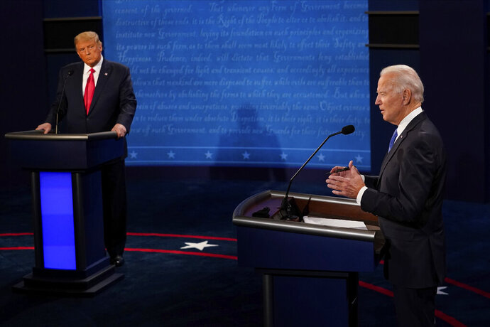 Democratic presidential candidate former Vice President Joe Biden answers a question as President Donald Trump listens during the second and final presidential debate Thursday, Oct. 22, 2020, at Belmont University in Nashville, Tenn. (AP Photo/Morry Gash, Pool)