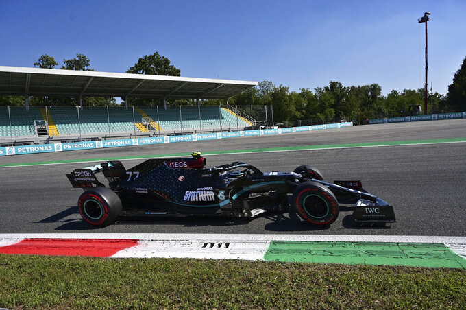 Mercedes driver Valtteri Bottas of Finland steers his car during the qualifying session at the Monza racetrack in Monza, Italy, Saturday, Sept.5, 2020. The Italian Formula One Grand Prix will be held on Sunday. (Miguel Medina, Pool via AP)