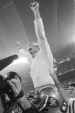 FILE - In this Jan. 25, 1982, file photo, San Francisco 49ers coach Bill Walsh raises his arms in victory as he is carried off the field by his players after their 26-21 Super Bowl XVI win over Cincinnati Bengals in Pontiac, Mich. The San 49ers ruled most of the 1980s by winning Super Bowls after the 1981, '84, '88 and '89 seasons.(AP Photo/File)