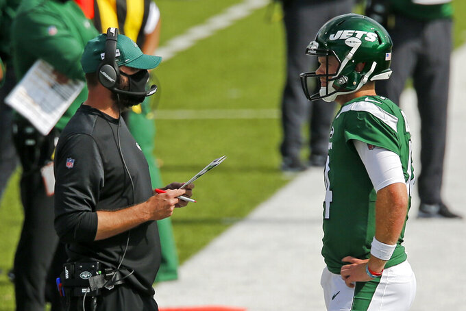 New York Jets head coach Adam Gase, left, talks with quarterback Sam Darnold during the second half of an NFL football game against the Buffalo Bills in Orchard Park, N.Y., Sunday, Sept. 13, 2020. (AP Photo/John Munson)