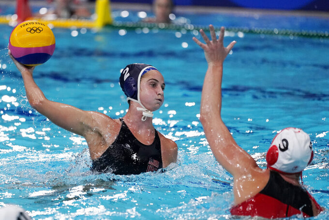 United States' Madeline Musselman (2) shoots against Canada's Hayley McKelvey (9) during a quarterfinal round women's water polo match at the 2020 Summer Olympics, Tuesday, Aug. 3, 2021, in Tokyo, Japan. (AP Photo/Mark Humphrey)