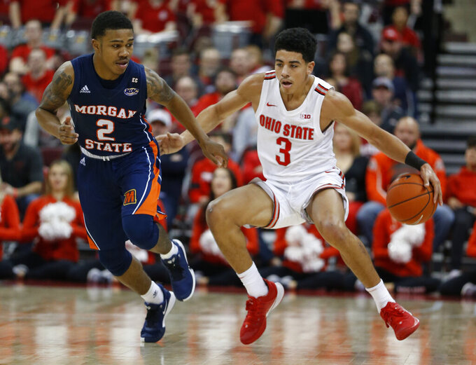 Ohio State's D.J. Carton, right, brings the ball up court as Morgan State's Isaiah Burke defends during the second half of an NCAA college basketball game Friday, Nov. 29, 2019, in Columbus, Ohio. Ohio State beat Morgan State 90-57. (AP Photo/Jay LaPrete)