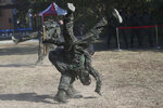 Members of Amphibious Search Team perform during a military exercise in Kaohsiung, southern Taiwan, Thursday, Jan. 16, 2020. Taiwan military is holding a two-day joint forces exercises to show its determination to defend itself from Chinese threats. (AP Photo/Chiang Ying-ying)