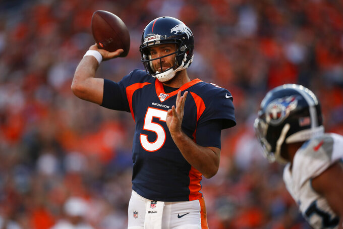 Denver Broncos quarterback Joe Flacco prepares to throw a pass during the second half of an NFL football game against the Tennessee Titans, Sunday, Oct. 13, 2019, in Denver. (AP Photo/David Zalubowski)