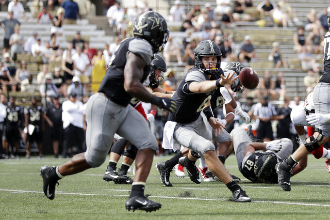 Vanderbilt quarterback Riley Neal (6) pitches the ball to running back Ke'Shawn Vaughn, left, in the second half of an NCAA college football game against Northern Illinois Saturday, Sept. 28, 2019, in Nashville, Tenn. Vanderbilt won 24-18. (AP Photo/Mark Humphrey)