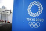 A security guard stands guard at one of the venues for the Tokyo 2020 Olympic Games in Tokyo, Tuesday, May 12, 2020. Japan is still under a coronavirus state of emergency, which was extended this week until the end of May, though there have been no hard lockdowns. (AP Photo/Eugene Hoshiko)
