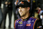 FILE - In this  Feb. 13, 2016, file photo, Denny Hamlin smiles during an interview after he won the NASCAR Sprint Unlimited auto race at Daytona International Speedway in Daytona Beach, Fla. Hamlin closed NASCAR's iRacing Series virtual auto race with a victory at a simulation of throwback North Wilkesboro Speedway on Saturday, May 9, 2020. (AP Photo/John Raoux, File)