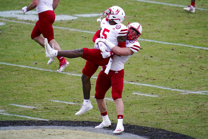 Nebraska cornerback Cam Taylor-Britt (5) and linebacker Garrett Nelson (44) celebrate a stop on fourth down against Purdue during the second quarter of an NCAA college football game in West Lafayette, Ind., Saturday, Dec. 5, 2020. (AP Photo/Michael Conroy)