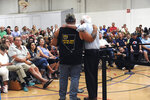 Democratic presidential candidate Sen. Bernie Sanders interacts with Trump supporter Bill Herron during a campaign stop at the Carson City Community Center Gymnasium, Friday, Sept. 13, 2019 in Carson City, Nev. (Jason Bean/The Reno Gazette-Journal via AP)