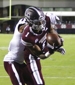 Mississippi State wide receiver Stephen Guidry (1) catches a pass for a touchdown ahead of Texas A&M defensive back Charles Oliver (21) during the first half of their NCAA college football game on Saturday, Oct. 27, 2018, in Starkville, Miss. (AP Photo/Jim Lytle)