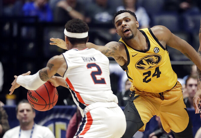 Missouri forward Kevin Puryear (24) defends against Auburn guard Bryce Brown (2) in the second half of an NCAA college basketball game at the Southeastern Conference tournament Thursday, March 14, 2019, in Nashville, Tenn. Auburn won 81-71. (AP Photo/Mark Humphrey)