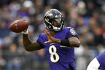Baltimore Ravens quarterback Lamar Jackson throws a pass against the Houston Texans prior to an NFL football game, Sunday, Nov. 17, 2019, in Baltimore. (AP Photo/Nick Wass)