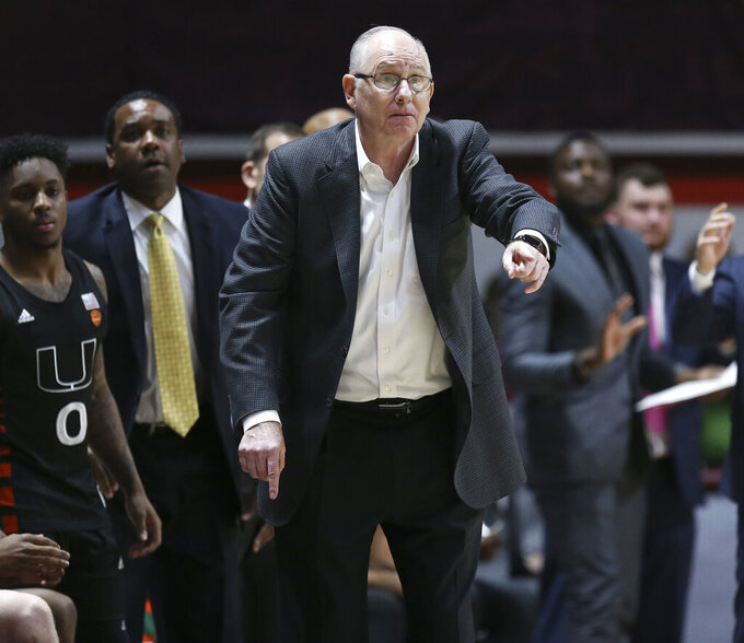 """FILE - In this Feb. 19, 2020, file photo, Miami coach Jim Larranaga gestures during the third overtime in the team's NCAA college basketball game against Virginia Tech in Blacksburg, Va. Nearing the end of his 34th season as a college coach, Larranaga has no plans to quit anytime soon _ or ever. The Hurricanes begin the final week of the regular season with a 14-14 record, leaving Larranaga to in danger of back-to-back losing seasons for the first time since 1991-93 at Bowling Green. But Larranaga believes the Miami program is on the verge of a turnaround, and he expects to be part of it. """"I love coaching,"""" the 70-year-old Larranaga said Monday, March 2, 2020. """"Honestly, I can't see myself doing anything else.(Matt Gentry/The Roanoke Times via AP, File)"""