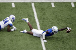 Kansas wide receiver Daylon Charlot (2) dives for extra yards after being tackled by Indiana State defensive back Mekhi Ware (14) during the second half of an NCAA college football game Saturday, Aug. 31, 2019, in Lawrence, Kan. Kansas won 24-17. AP Photo/Charlie Riedel)
