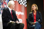 Roger Penske, left, speaks with Iowa Gov. Kim Reynolds, right, during a news conference at Hy-Vee Corp. headquarters, Thursday, Aug. 19, 2021, in West Des Moines, Iowa. IndyCar will return next season to Iowa Speedway, a short oval track beloved by fans and drivers that had fallen off the schedule after 14 years. The track located in Newton will host a doubleheader next July in a deal brokered between IndyCar Series owner Roger Penske, team owner Bobby Rahal and grocery chain Hy-Vee. (AP Photo/Charlie Neibergall)