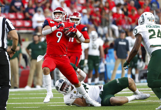 Fresno State running back Josh Hokit (9) runs past a Colorado State defender to set up a touchdown during the first half of an NCAA college football game in Fresno, Calif., Saturday, Oct. 26 2019. (AP Photo/Gary Kazanjian)