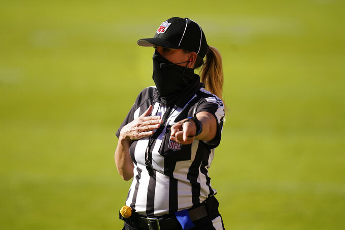 Down Judge Sarah Thomas signaling on the field during the first half of an NFL football game between the New York Giants and Washington Football Team, Sunday, Nov. 8, 2020, in Landover, Md. (AP Photo/Patrick Semansky)