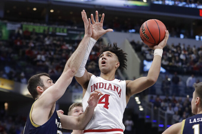 Indiana's Trayce Jackson-Davis (4) shoots over Notre Dame's John Mooney (33) during the second half of an NCAA college basketball game, Saturday, Dec. 21, 2019. Indiana won 62-60 (AP Photo/Darron Cummings)