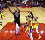 Houston Rockets guard Eric Gordon (10) drives to the basket past Los Angeles Lakers center JaVale McGee, right front, during the first half of an NBA basketball game Saturday, Jan. 19, 2019, in Houston. (AP Photo/Eric Christian Smith)