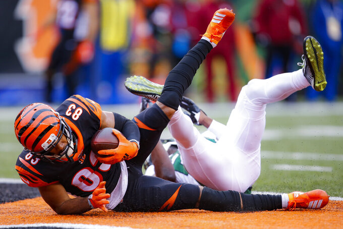 Cincinnati Bengals wide receiver Tyler Boyd (83) catches a touchdown pass during the first half of an NFL football game against the New York Jets, Sunday, Dec. 1, 2019, in Cincinnati. (AP Photo/Gary Landers)