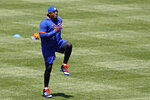 New York Mets left fielder Yoenis Cespedes warms up during the afternoon session of a summer  baseball training camp workout at Citi Field, Thursday, July 9, 2020, in New York. (AP Photo/Kathy Willens)