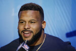 Los Angeles Rams' Aaron Donald answers questions during Opening Night for the NFL Super Bowl 53 football game, Monday, Jan. 28, 2019, in Atlanta. (AP Photo/Matt Rourke)