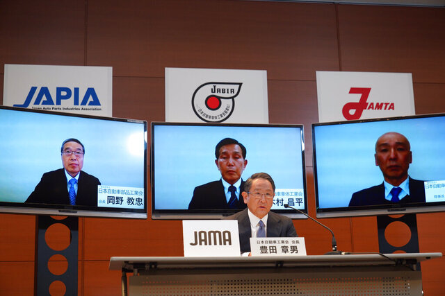 In this photo provided by Toyota Motor Corp., Toyota Chief Executive Akio Toyoda speaks during a video meeting at his office in Nagoya, central Japan, Friday, April 10, 2020. Toyoda promised Friday the Japanese auto industry would protect jobs, as it braces to overcome the unfolding crisis set off by the coronavirus pandemic. Toyoda, speaking as head of the Japan Automobile Manufacturers Association, said he was worried the Japanese economy might be destroyed before the world can win the fight against the sickness caused by COVID-19. (Toyota Motor Corp. via AP)