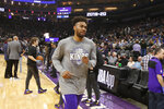 Sacramento Kings forward Jabari Parker runs off the court after the team's NBA basketball game against the New Orleans Pelicans was postponed at the last minute in Sacramento, Calif., Wednesday, March 11, 2020. The game was postponed at the last minute due to what the league said was an