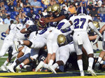 Navy quarterback Malcolm Perry goes over the top to score in the second quarter of an NCAA college football game against Holy Cross, Saturday, Aug. 31, 2019, in Annapolis, Md. (Paul W. Gillespie/Capital Gazette via AP)