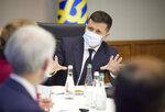 Ukrainian President Volodymyr Zelenskiy, center, talks to U.S. Senators Jeanne Shaheen, D-N.H., Rob Portman, R-Ohio, and Chris Murphy D-Conn., during their meeting in Kyiv, Ukraine, Wednesday, June 2, 2021. (Ukrainian Presidential Press Office via AP)