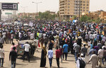 Sudanese protesters march during a demonstration against the military council, in Khartoum, Sudan, Sunday, June 30, 2019. Tens of thousands of protesters have taken to the streets in Sudan's capital and elsewhere in the country calling for civilian rule nearly three months after the army forced out long-ruling autocrat Omar al-Bashir. The demonstrations came amid a weekslong standoff between the ruling military council and protest leaders. (AP Photo/Hussein Malla)