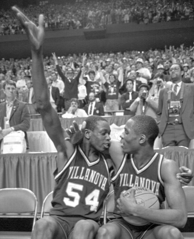 FILE - In this April 1, 1985, file photo, Villanova's Ed Pinckney (54) and Dwayne McLain celebrate after playing their last college basketball game, upsetting Georgetown 66-64 in the NCAA college basketball Final Four championship game, in Lexington, Ky. (AP Photo/File)