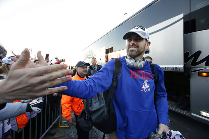New England Patriots kicker Stephen Gostkowski, right, greets fans following the football teams arrival at Gillette Stadium, Monday, Feb. 4, 2019, in Foxborough, Mass., after defeating the Los Angeles Rams Sunday in NFL Super Bowl 53, in Atlanta, Ga. (AP Photo/Steven Senne)