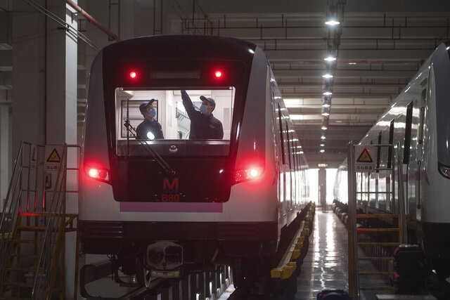 In this March 23, 2020 photo released by Xinhua News Agency, workers prepares a subway train for restoration of public transport in Wuhan, in central China's Hubei province. China's health ministry says Wuhan has now gone several consecutive days without a new infection, showing the effectiveness of draconian travel restrictions that are slowly being relaxed around the country. (Xiao Yijiu/Xinhua via AP)