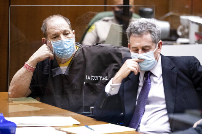 Harvey Weinstein, left, the 69-year-old convicted rapist and disgraced movie mogul, listens alongside Mark Werksman, one of his attorneys, during a pre-trial hearing in Los Angeles, Thursday, 29 July 2021.  (Etienne Laurent/Pool Photo via AP)