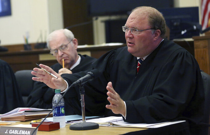 FILE- In this Sept. 17, 2015 file photo, then Wisconsin Supreme Court Justice Michael J. Gableman speaks during a court hearing at the Grant County Courthouse in Lancaster, Wis. Wisconsin election clerks are reacting with a mixture of confusion, concern and bewilderment to thefirst inquiry made by former Wisconsin Supreme Court Justice Michael Gableman, a special investigatorhired by Republicans to examine how the 2020 presidential election was run in the battleground state. (Jessica Reilly/Telegraph Herald via AP, File)