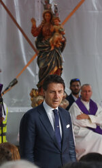 Italian Premier Giuseppe Conte attend a remembrance ceremony to mark the first anniversary of the Morandi bridge collapse, in Genoa, Italy, Wednesday, Aug. 14, 2019. The Morandi bridge was a road viaduct on the A10 motorway in Genoa, that collapsed one year ago killing 43 people. (AP Photo/Antonio Calanni)