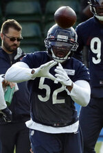 Chicago Bears' outside linebacker Khalil Mack, 52, takes part in an NFL training session at the Allianz Park stadium in London, Friday, Oct. 4, 2019. The Chicago Bears are preparing for an NFL regular season game against the Oakland Raiders in London on Sunday. (AP Photo/Matt Dunham)