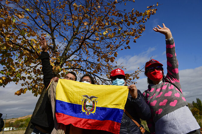Ecuadorian fans cheer Ineos's Richard Carapaz before the start of the eight stage of La Vuelta between Logrono and Alto de Moncalvillo, in Logrono, northern Spain, Wednesday, Oct. 28, 2020. (AP Photo/Alvaro Barrientos)