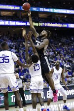 Providence's Nate Watson (0) shoots over Seton Hall's Myles Powell (13) as Quincy McKnight (0) watches during the first half of an NCAA college basketball game Wednesday, Jan. 22, 2020, in Newark, N.J. (AP Photo/Frank Franklin II)