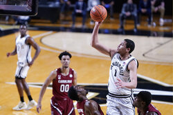 Vanderbilt forward Dylan Disu (1) shoots over South Carolina defenders in the first half of an NCAA college basketball game Saturday, Jan. 30, 2021, in Nashville, Tenn. (AP Photo/Mark Humphrey)