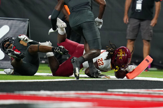 Iowa State running back Deon Silas (22) falls just short of the goal line during the second half of an NCAA college football game against UNLV, Saturday, Sept. 18, 2021, in Las Vegas. (AP Photo/John Locher)