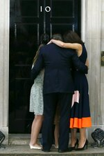 FILE - In this Wednesday, July 13, 2016 file photo Britain's Prime Minister David Cameron, his wife Samantha and their children Nancy, Elwen and Florence, hug on the steps of 10 Downing Street in London. Cameron stepped down after six years as prime minister. (AP Photo/Kirsty Wigglesworth, File)