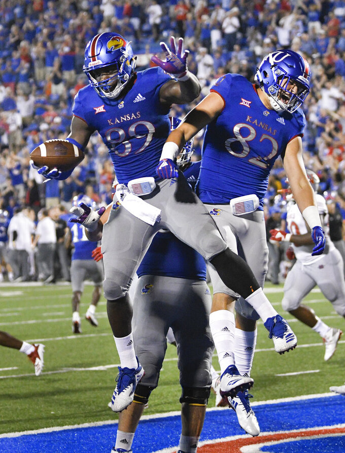 Kansas tight end Mavin Saunders (89) celebrates a two-point conversion with teammate James Sosinski (82) against Nicholls State during the second half of an NCAA college football game in Lawrence, Kan., Saturday, Sept. 1, 2018. (AP Photo/Reed Hoffmann)