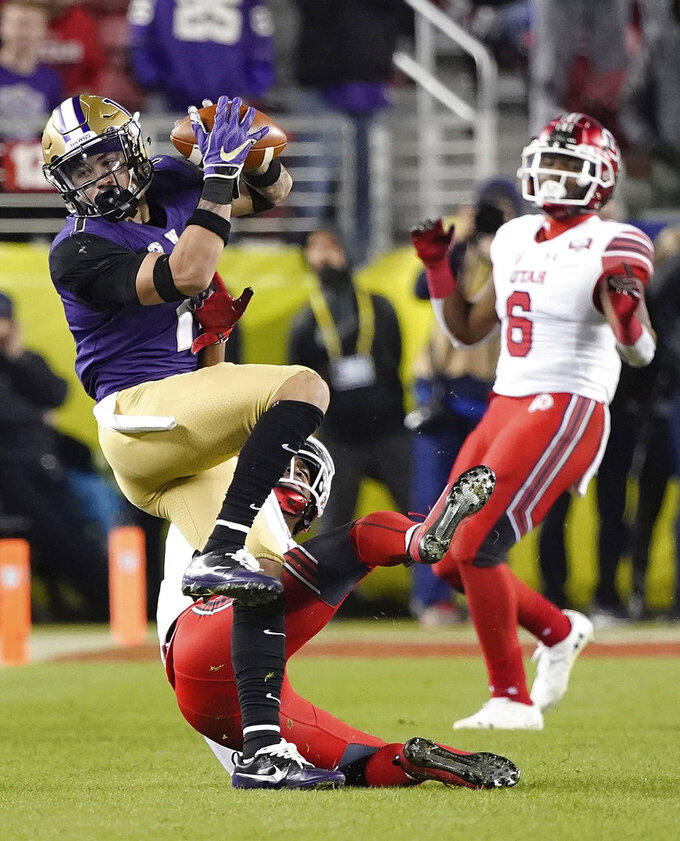 Washington defensive back Byron Murphy, left, intercepts a Utah pass during the second half of the Pac-12 Conference championship NCAA college football game in Santa Clara, Calif., Friday, Nov. 30, 2018. (AP Photo/Tony Avelar)