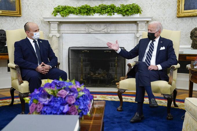 President Joe Biden meets with Israeli Prime Minister Naftali Bennett in the Oval Office of the White House, Friday, Aug. 27, 2021, in Washington. (AP Photo/Evan Vucci)