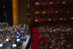 This photo provided by The Metropolitan Opera shows The Metropolitan Opera's music director Yannick Nézet-Séguin conducting the Verdi Requiem on Saturday, Sept. 11, 2021 at The Metropolitan Opera in New York.  Before a masked crowd of 3,600, Yannick Nézet-Séguin led a performance of the Verdi Requiem in commemoration of the 20th anniversary of the 9/11 terrorist attacks. The Met had not performance in its house since March 11, 2020, the longest gap since the company started in 1883. (Richard Termine/The Metropolitan Opera via AP)